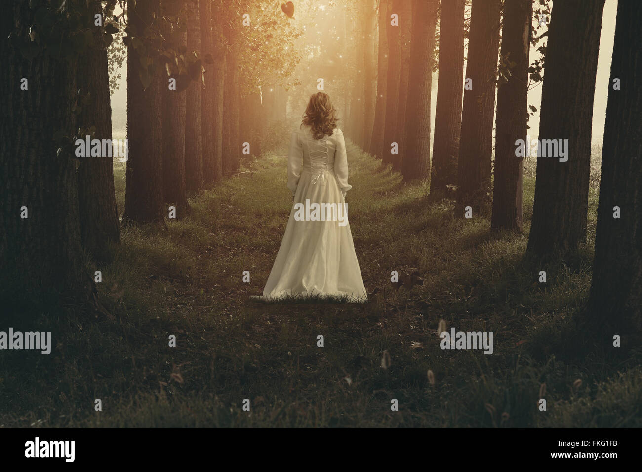 Woman with victorian dress in fairy and dreamy realm. Fantasy manipulation - Stock Image