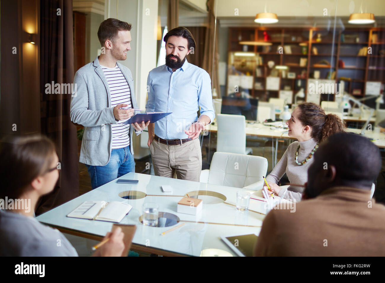 Casual business people working together at office - Stock Image