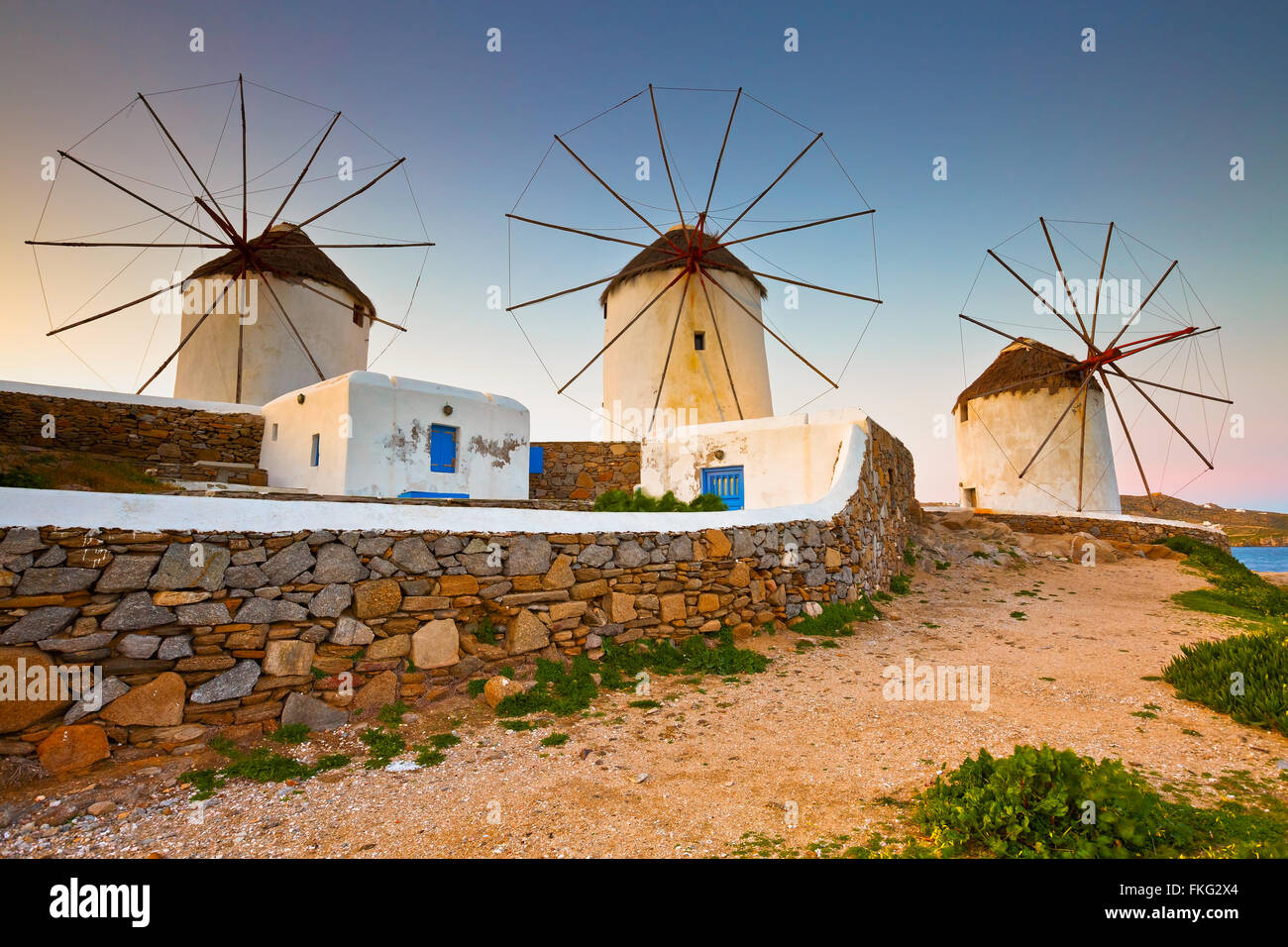 Old traditional windmills over the town of Mykonos. - Stock Image