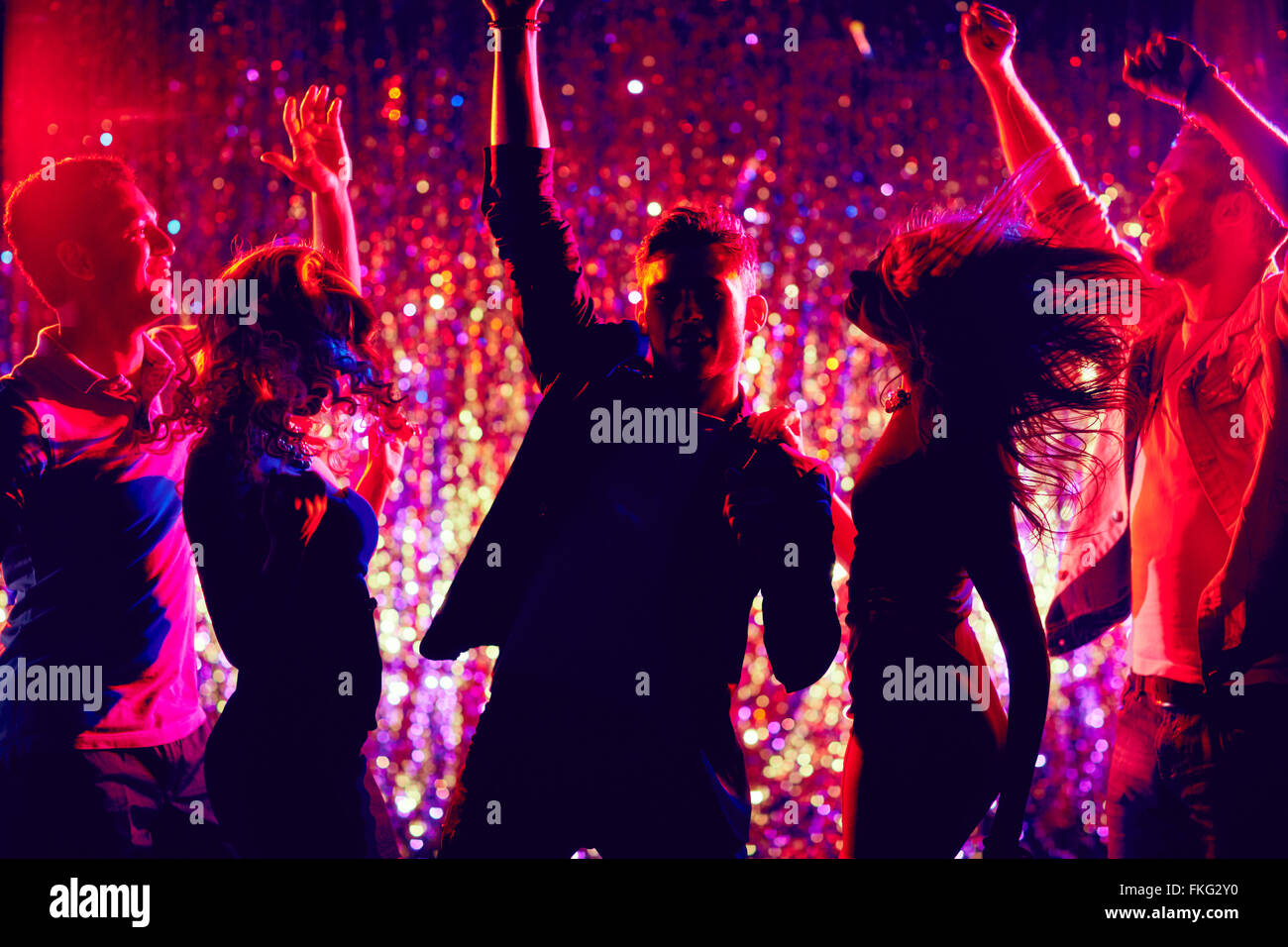 Young people dancing at party - Stock Image