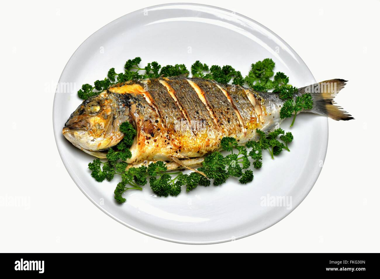 grilled sea bream with parsley exempted - Stock Image