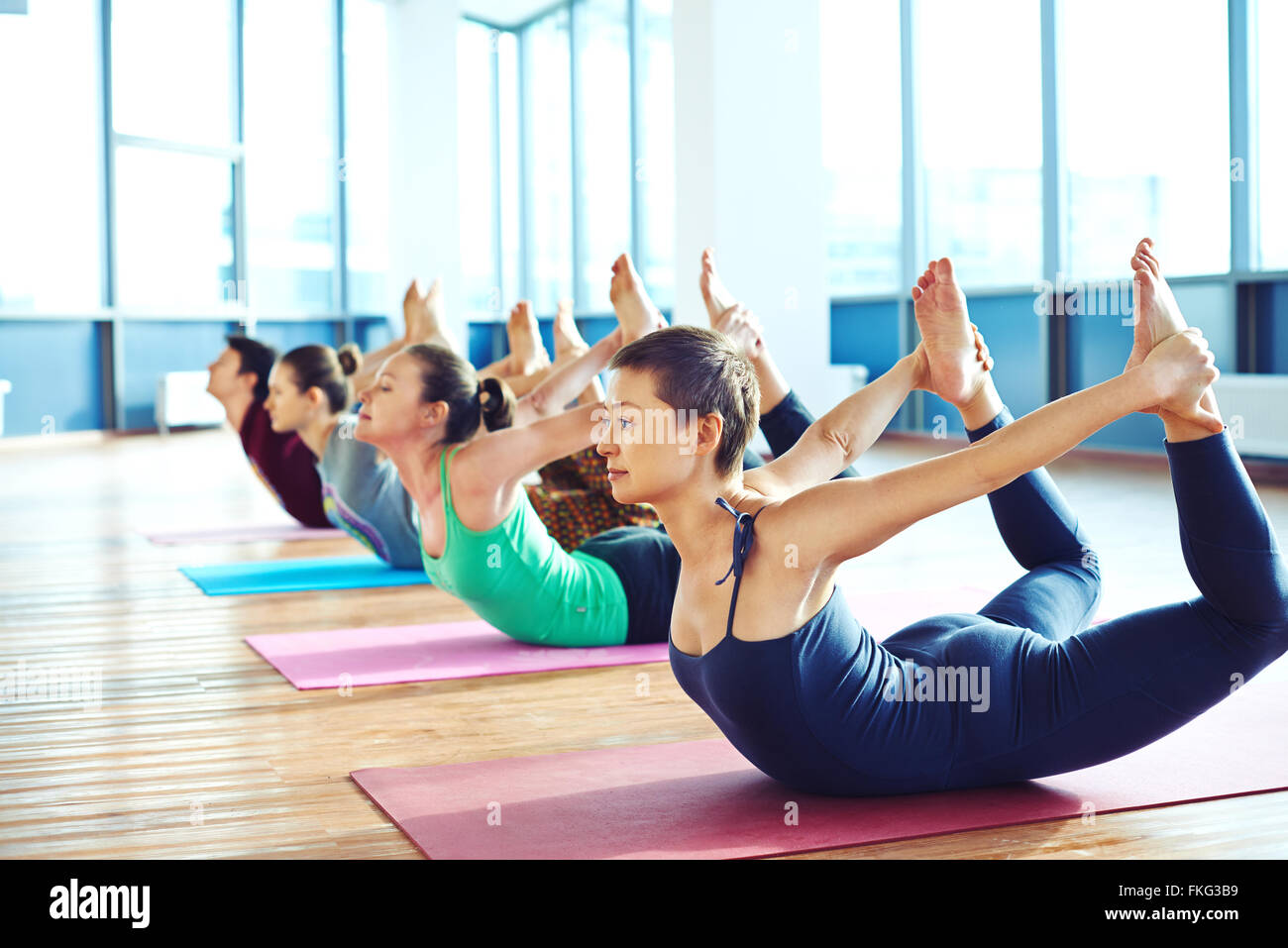 Group of young people relaxing and practicing in yoga Stock Photo