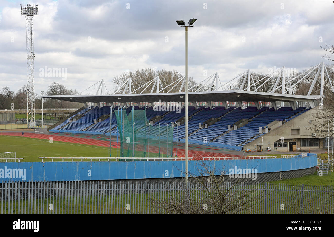 A lone,elderly runner practices on the athletics track at a deserted Crystal Palace Stadium. - Stock Image