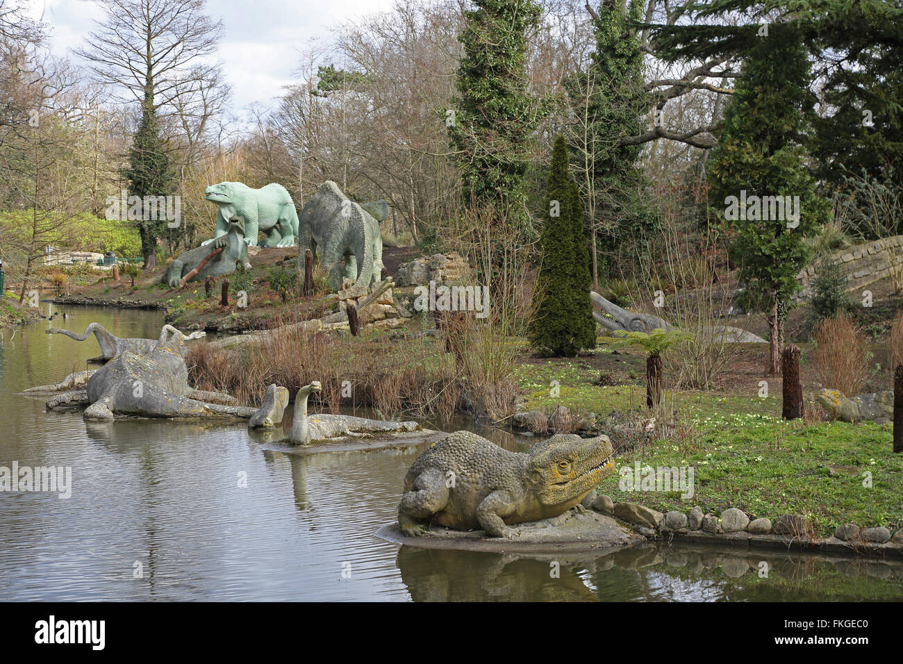 Life-size dinosaur statues in Crystal Palace Park, London. Erected as part of the Great Exhibition in 1854 Stock Photo