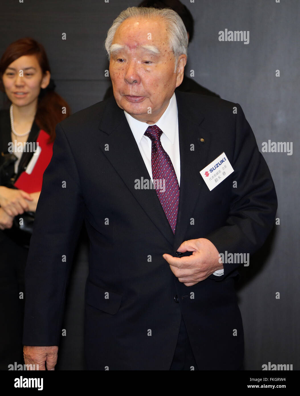 Tokyo, Japan. 9th Mar, 2016. Japanese automaker Suzuki Motor chairman Osamu Suzuki arrives at a conference hall - Stock Image