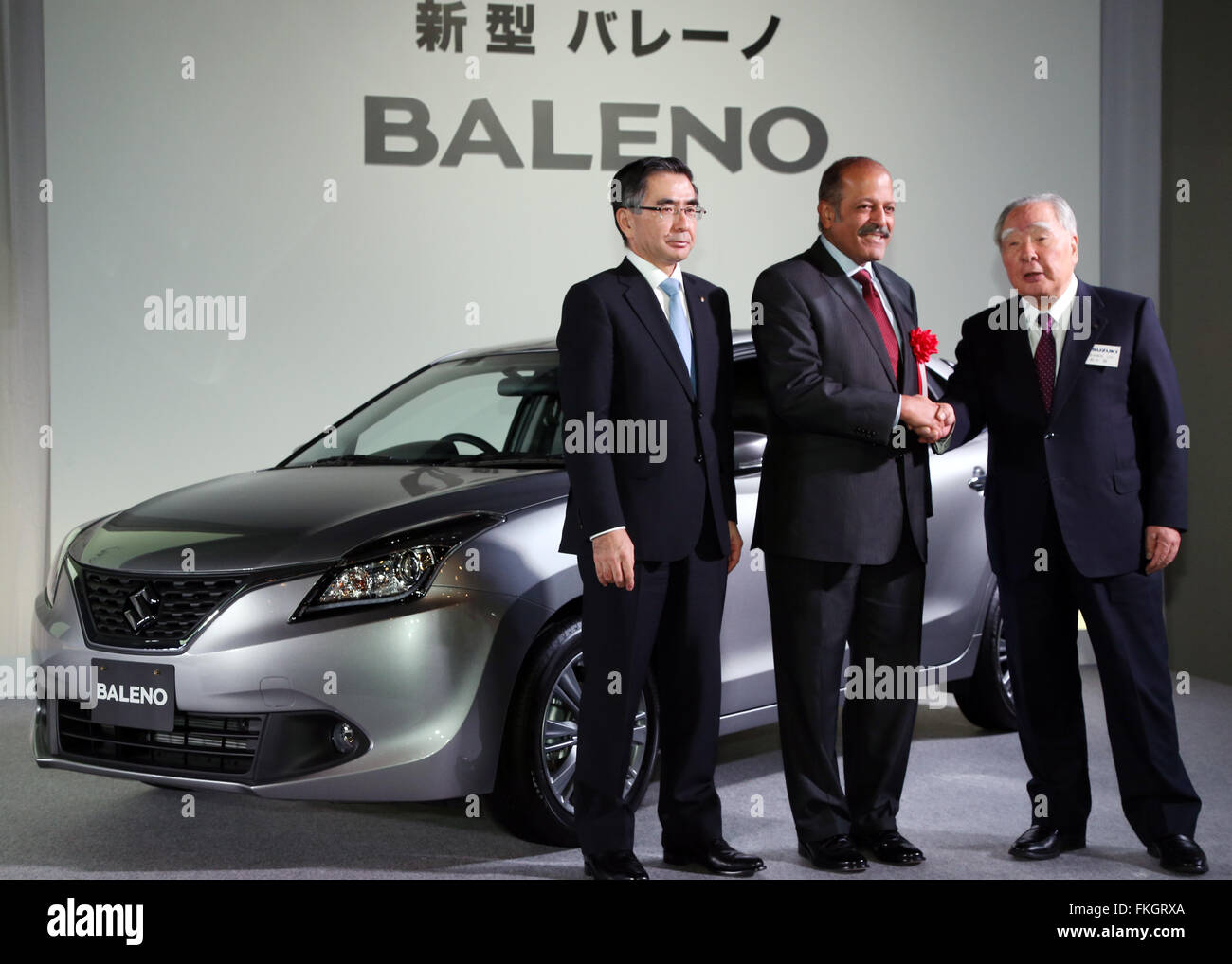 Tokyo, Japan. 9th Mar, 2016. Indian ambassador to Japan Sujan Chinoy (C) shakes hands with Japanese automaker Suzuki - Stock Image