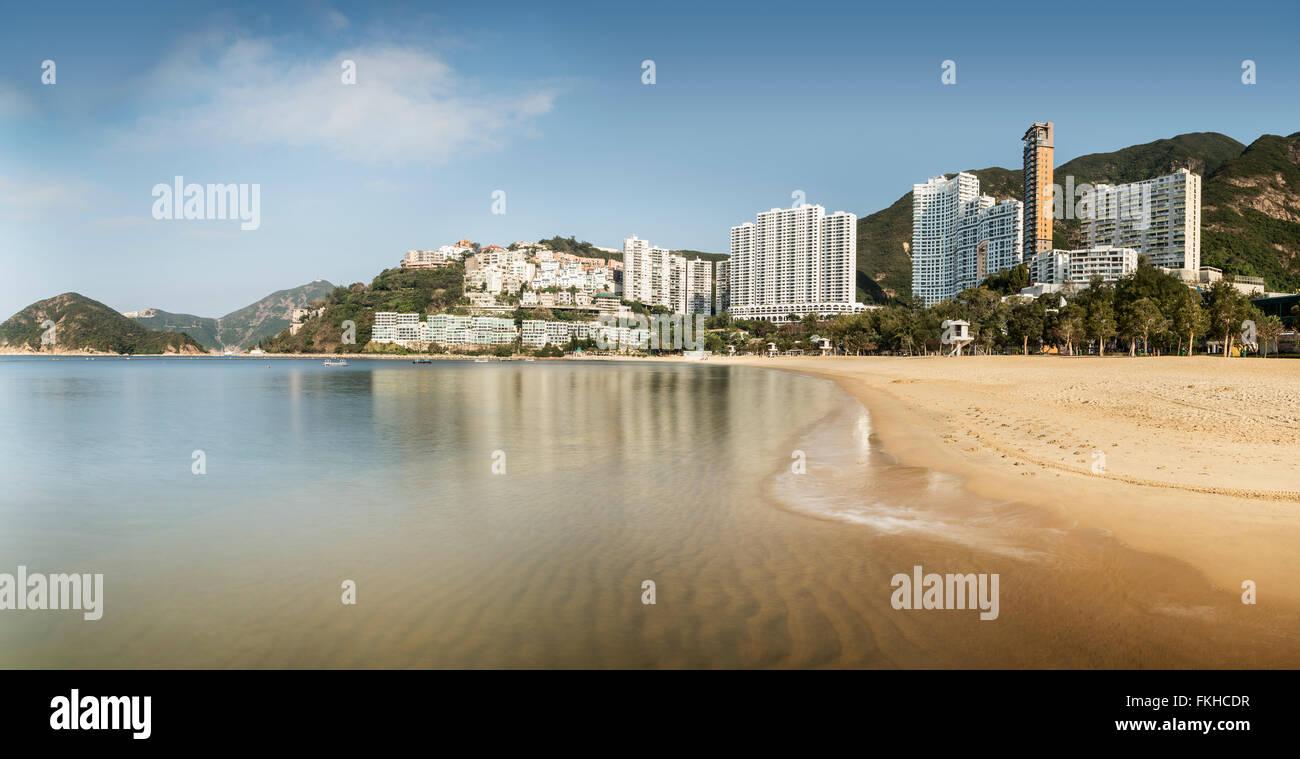 Beach and luxury skyscrapers at Repulse Bay, in Hong Kong, China - Stock Image