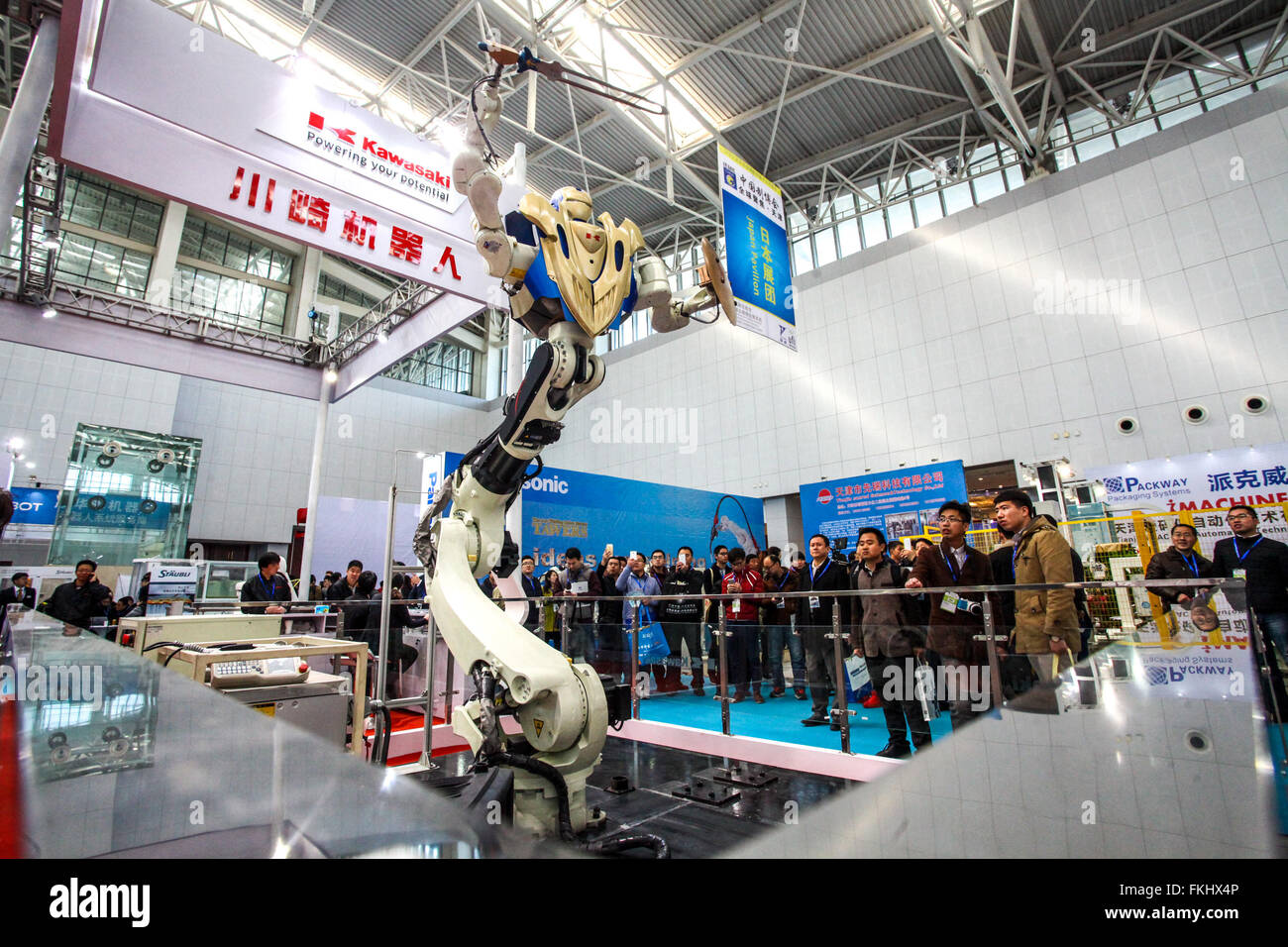 Tianjin, China. 9th Mar, 2016. A robot from a Japanese enterprise is programmed to wield a sword at the 5th China - Stock Image