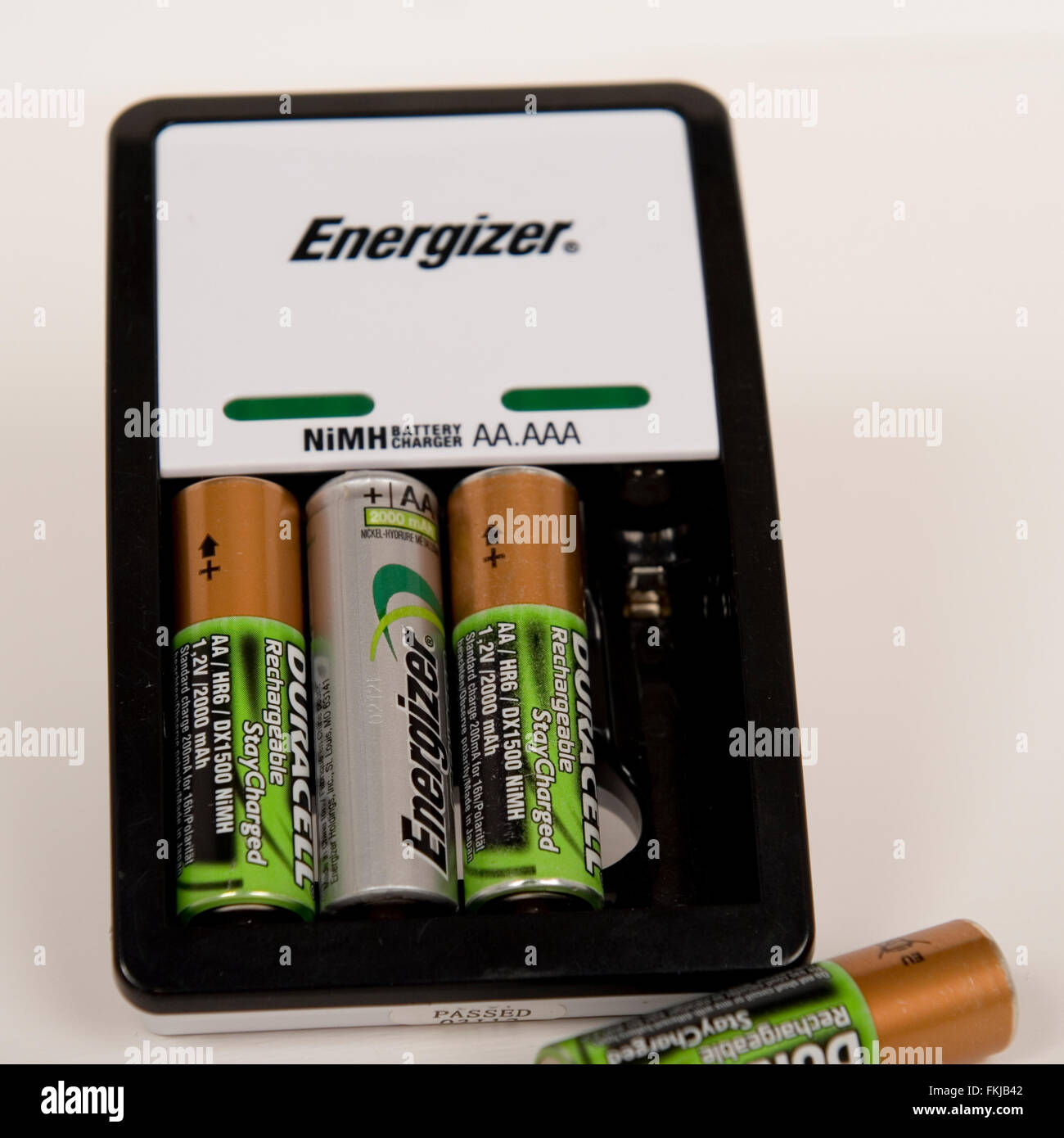 batteries and battery charger - Stock Image