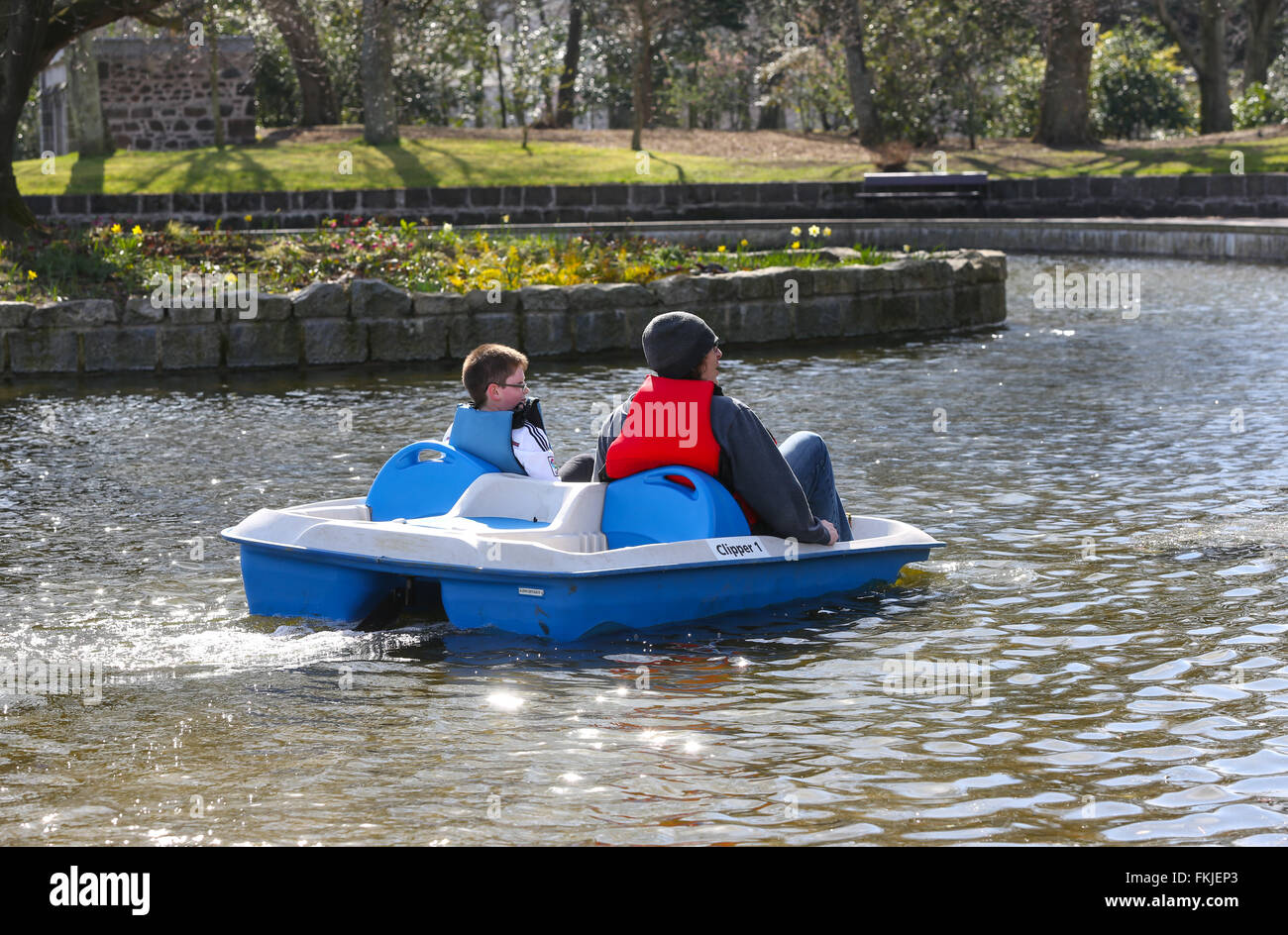 People enjoying a pedalo on the boating pond in Duthie Park, Aberdeen, Scotland, UK - Stock Image