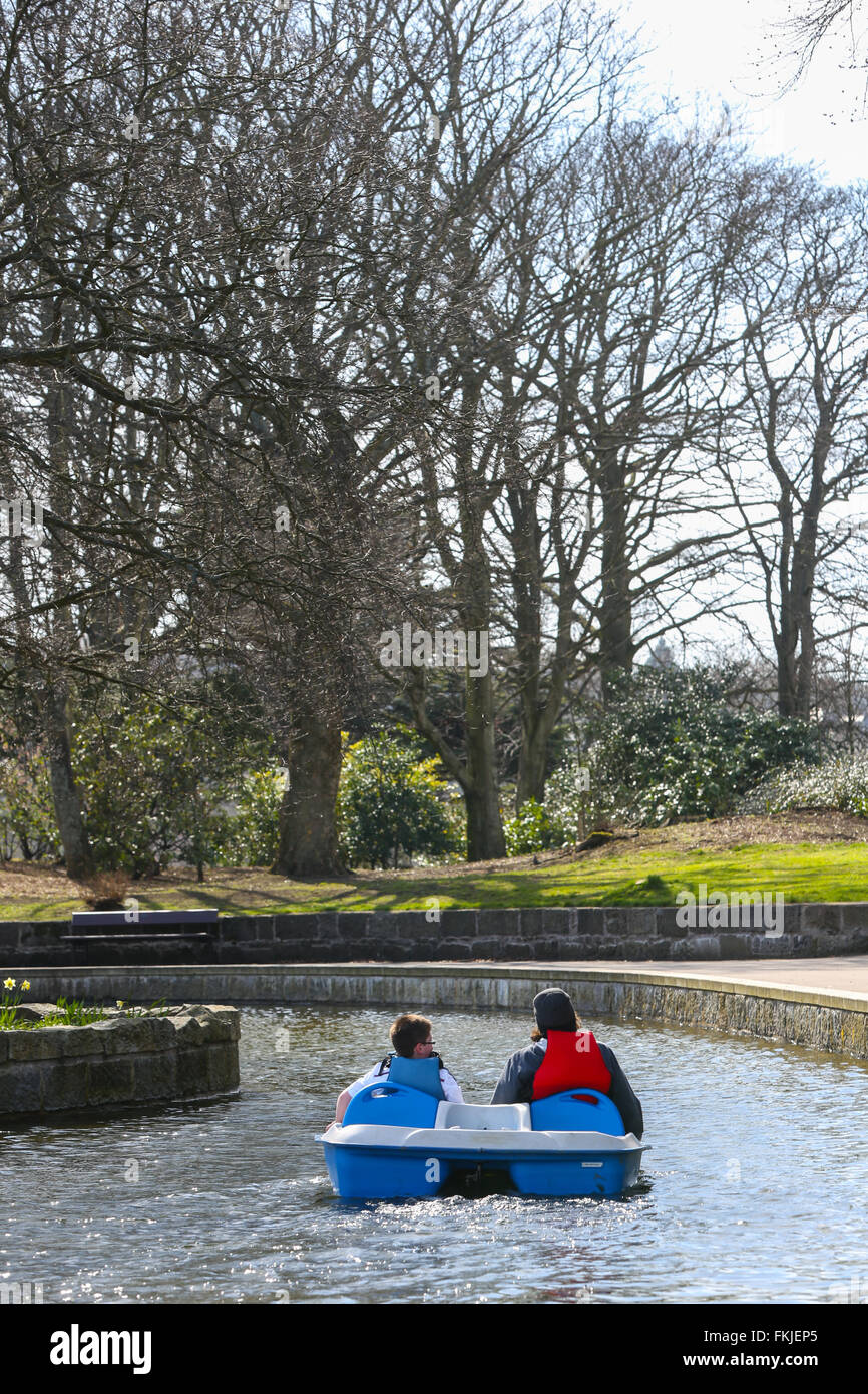 Pedal boats on the traditional boating pond within Duthie Park in the city of Aberdeen, Scotland, UK - Stock Image