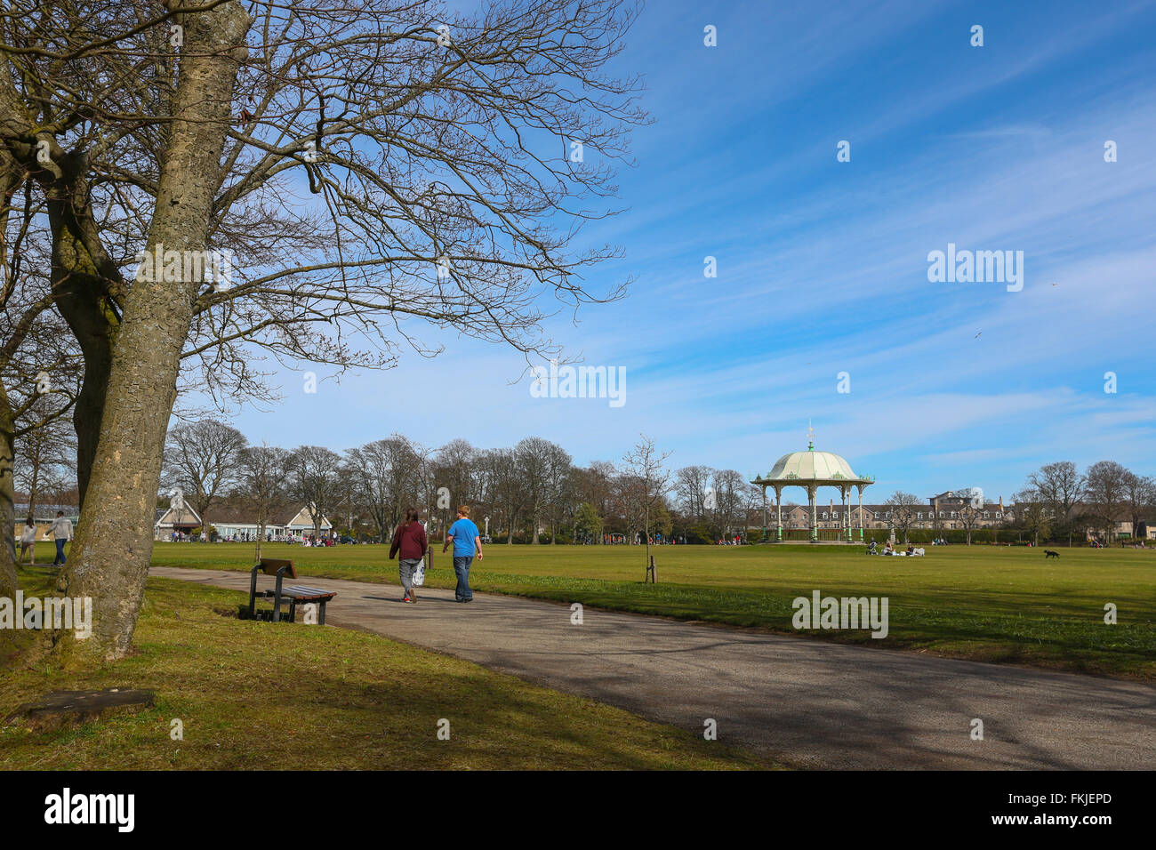 People walking by the traditional bandstand within Duthie Park in the city of Aberdeen, Scotland, UK - Stock Image