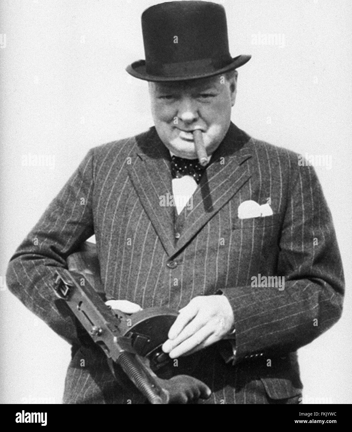 Sir Winston Churchill wartime image with a 'Tommy' gun. From the archives of Press Portrait Service - formerly - Stock Image