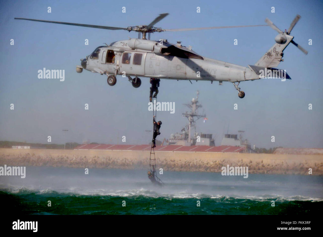 U.S Navy SEAL team Explosive Ordnance Disposal Mobile Unit special force commandos practice fast roping, rappelling, - Stock Image