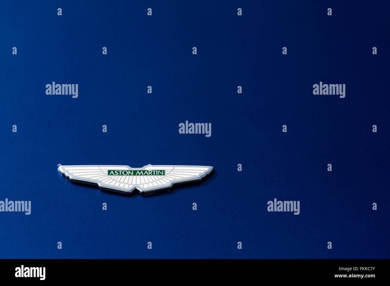 Aston Martin logo badge on metallic blue paint Stock Photo