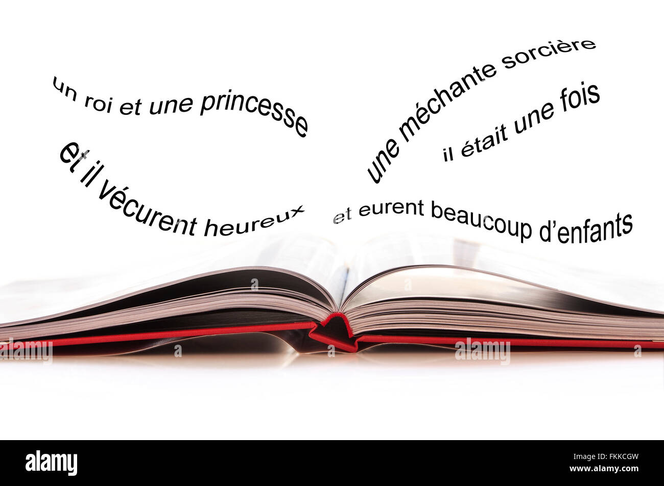 Open book, French text with the begining of an imaginary fairy tale - Stock Image