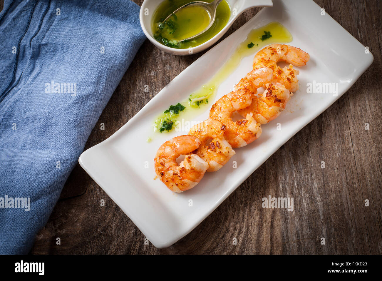 fresh grilled prawns with cilantro and parsley sauce - Stock Image