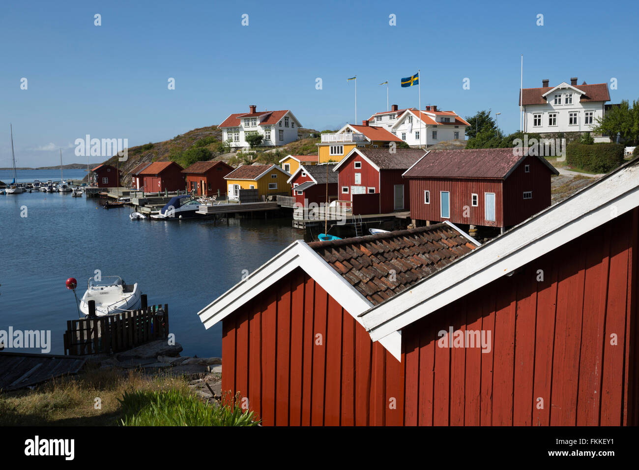 Falu red fishermen's houses in harbour, Hälleviksstrand, Orust, Bohuslän Coast, Southwest Sweden, Sweden, Scandinavia, Stock Photo