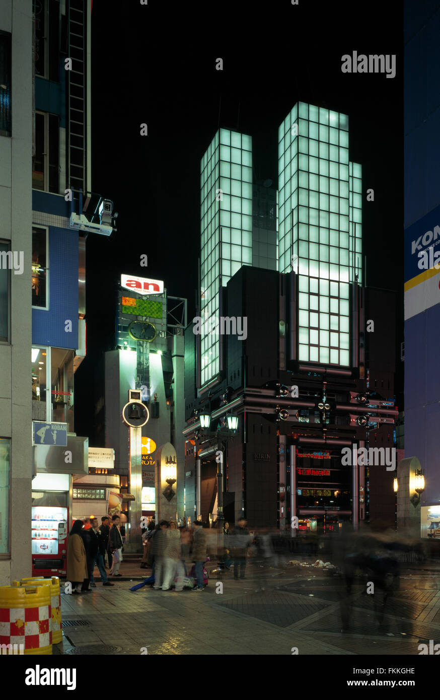 A street view of the Kirin Beer Building in Osaka. A night time view of the illuminated building. - Stock Image
