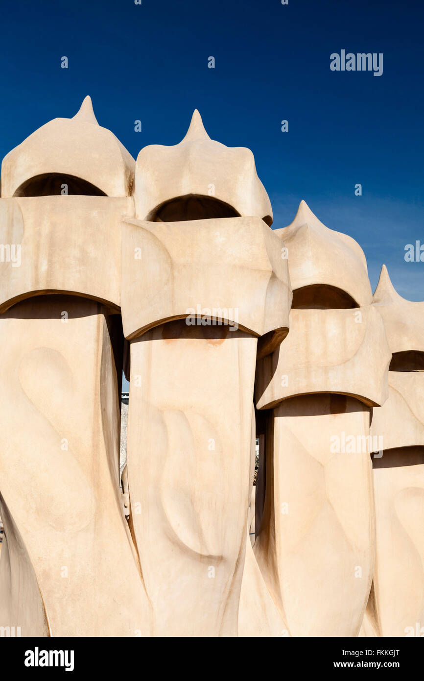 A view of artistic sculptures from below. On the rooftop of La Pedrera. - Stock Image