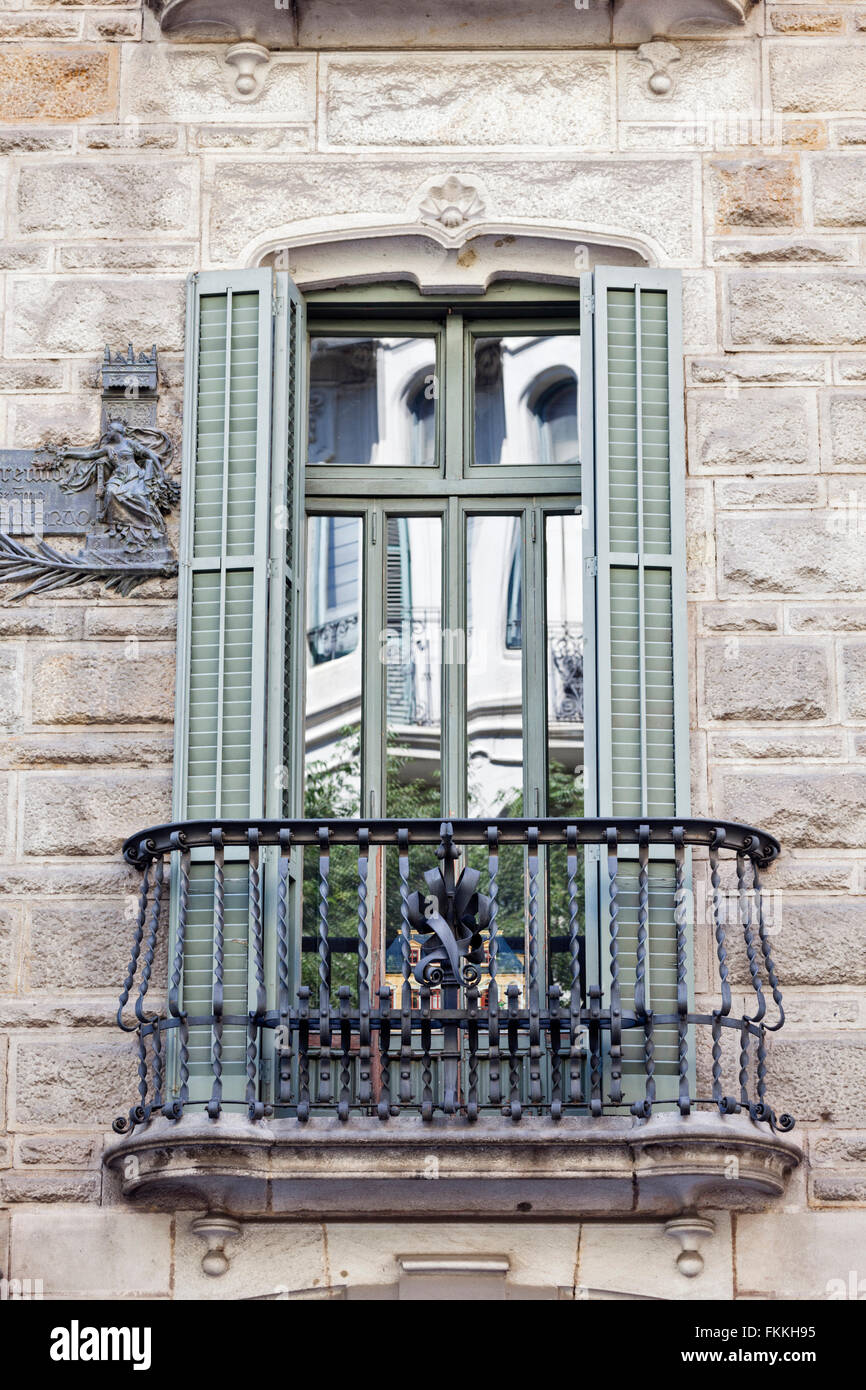 A view from below of the wrought iron balcony at the Casa Calvet. - Stock Image
