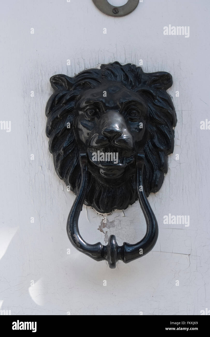 A black lion head door knocker on a door, of a residential house. - - Lion Head Door Knocker Stock Photos & Lion Head Door Knocker Stock