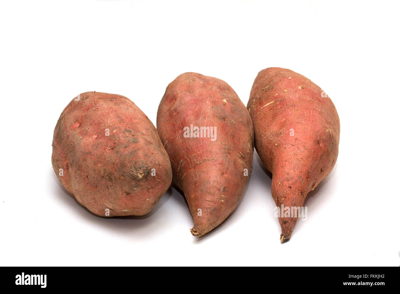 The sweet potato (Ipomoea batatas) is a large, starchy, sweet-tasting, tuberous root vegetable.  It is a staple - Stock Image