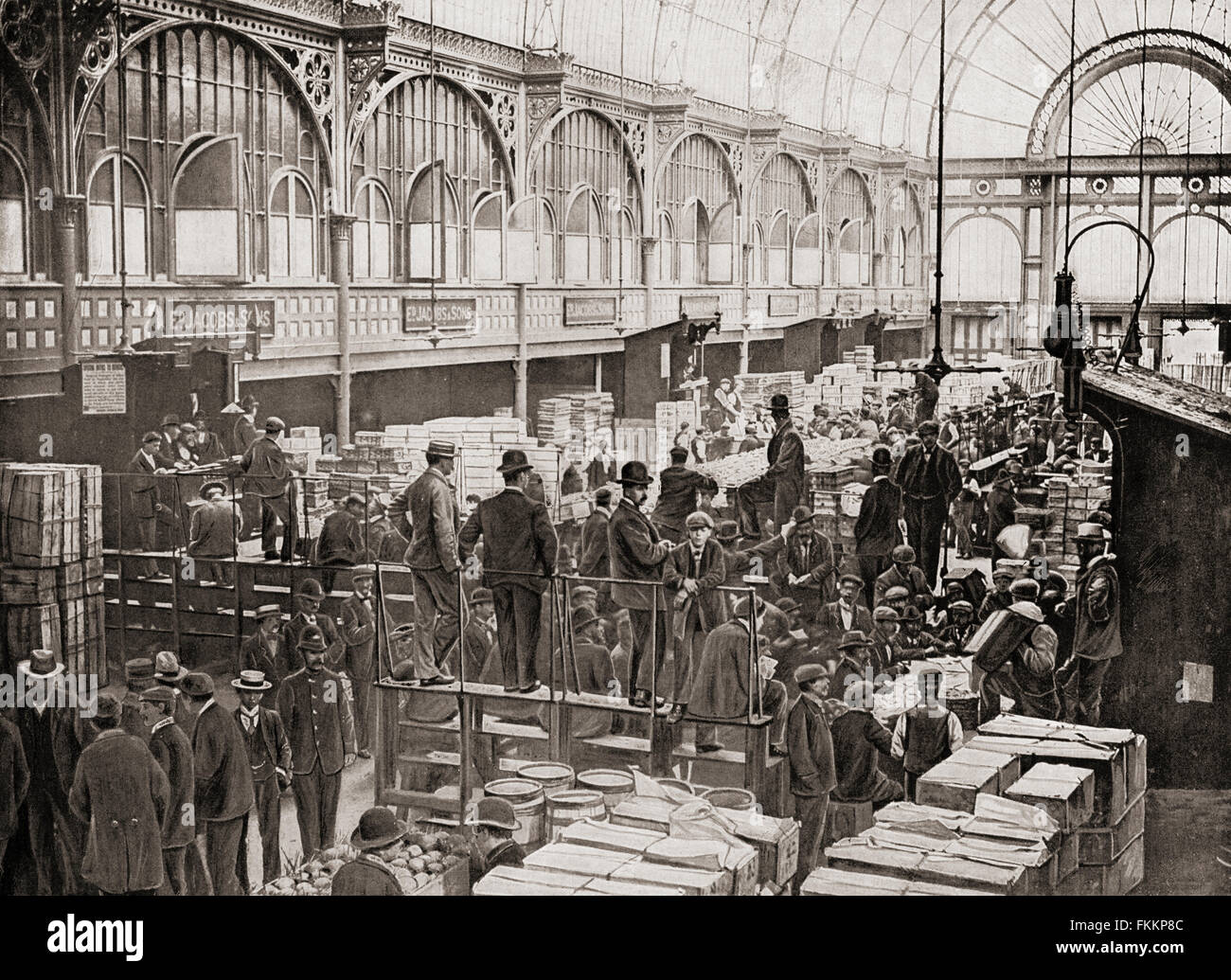 Fruit auctions at Covent Garden fruit and vegetable market, London, England in the late 19th century.  From Living Stock Photo