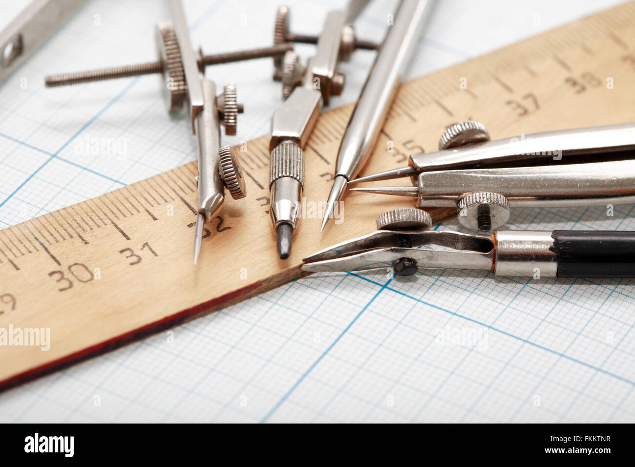 Set Of Drawing Instrument And Ruler On Graph Paper Stock Photo