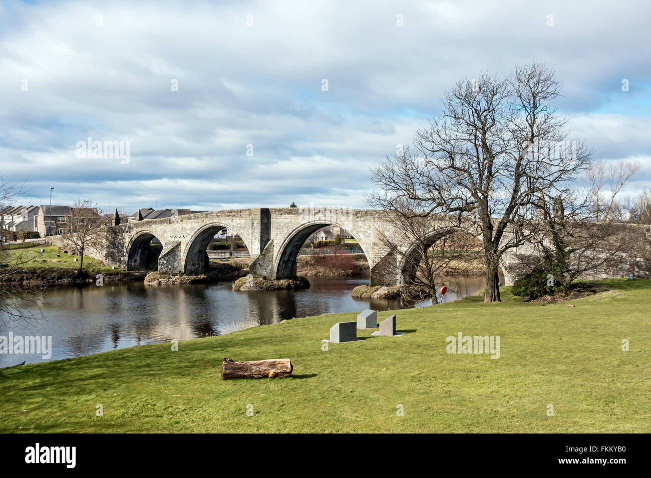 Stirling Old Bridge crossing the River Forth at Stirling in Scotland with part of battle field and plinths describing - Stock Image