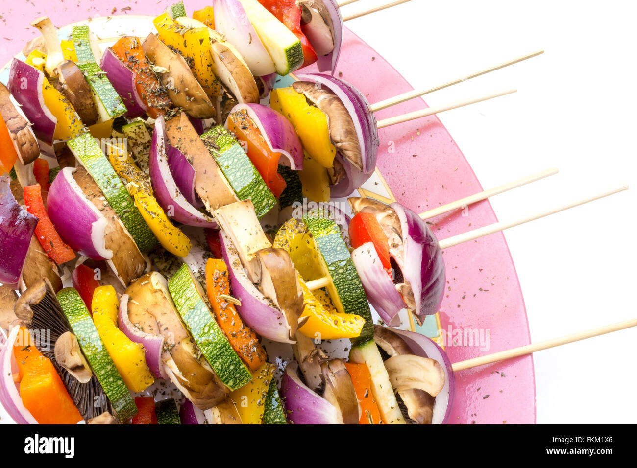 Low calorie bbq sticks with pieces of fresh vegetables as zucchini, mushroom, onion and bell pepper served with - Stock Image