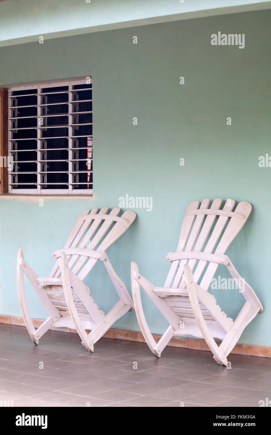 Rocking Chairs Lent Against Wall On Porch At Vinales, Pinar Del Rio  Province, Cuba, West Indies, Caribbean