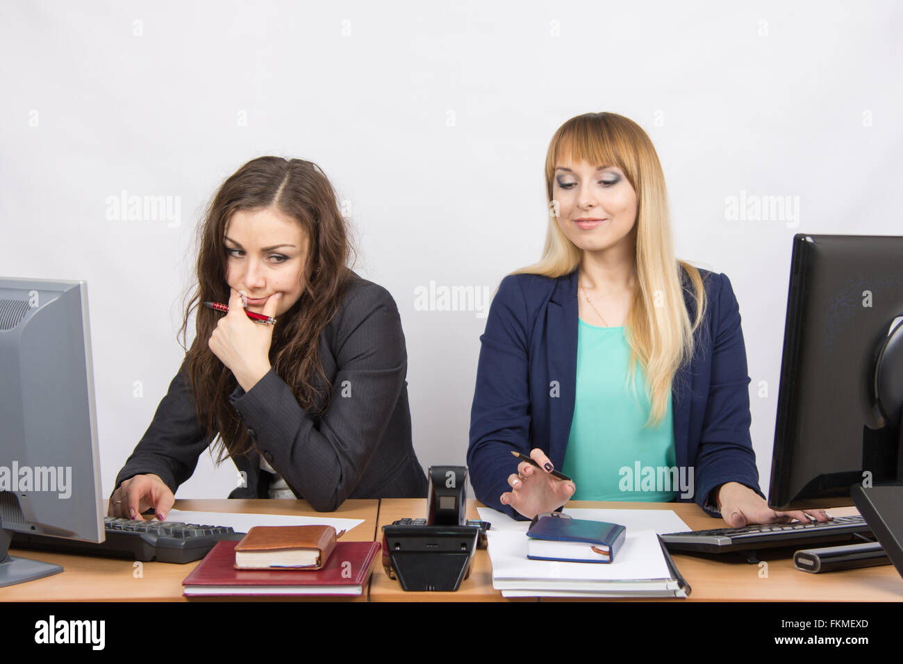 The situation in the office - the phone rang, the two collaborators looked at him - Stock Image