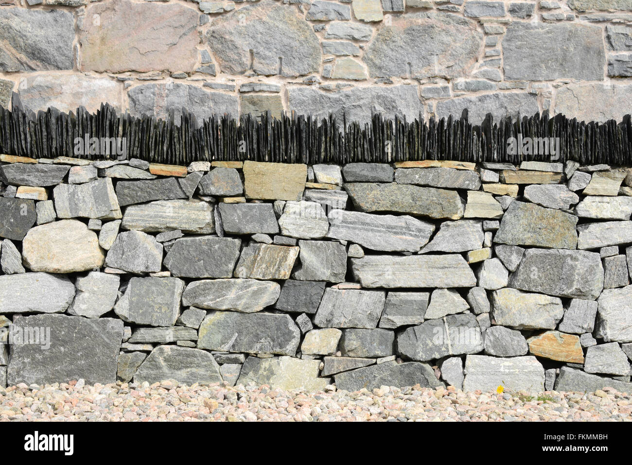 An immaculate new dry stone wall topped with vertical slates on the Isle of Harris, Outer Hebrides, Scotland - Stock Image