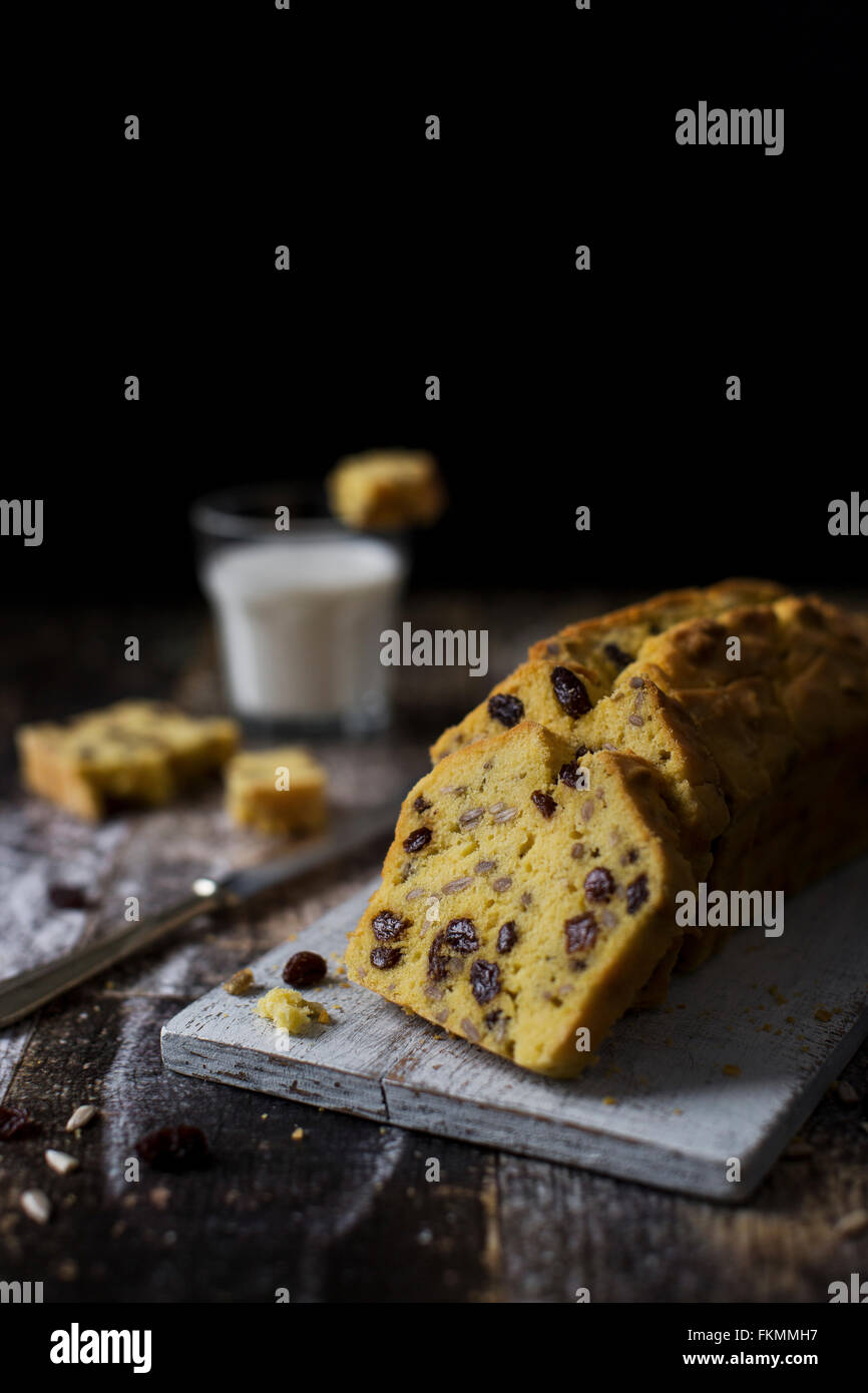 Quick, moist and buttery gluten free cake with cornflour, raisins and sunflower seeds - Stock Image