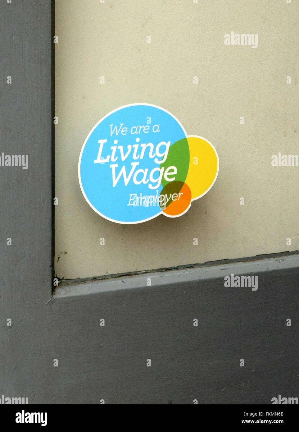 Living Wage Employer sign in Oliver Bonas shop window, Islington, London - Stock Image
