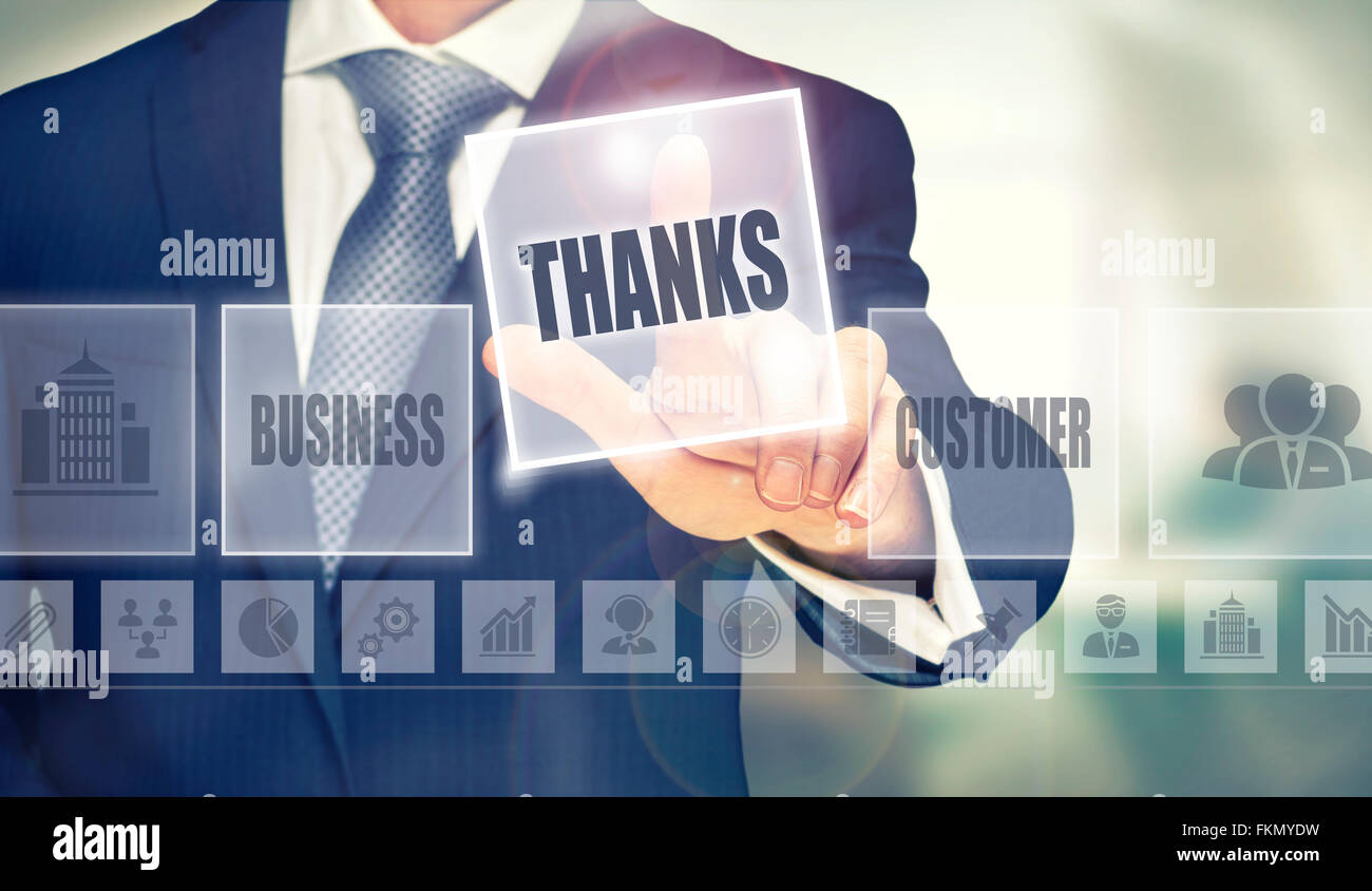 Businessman pressing a Thanks concept button. - Stock Image