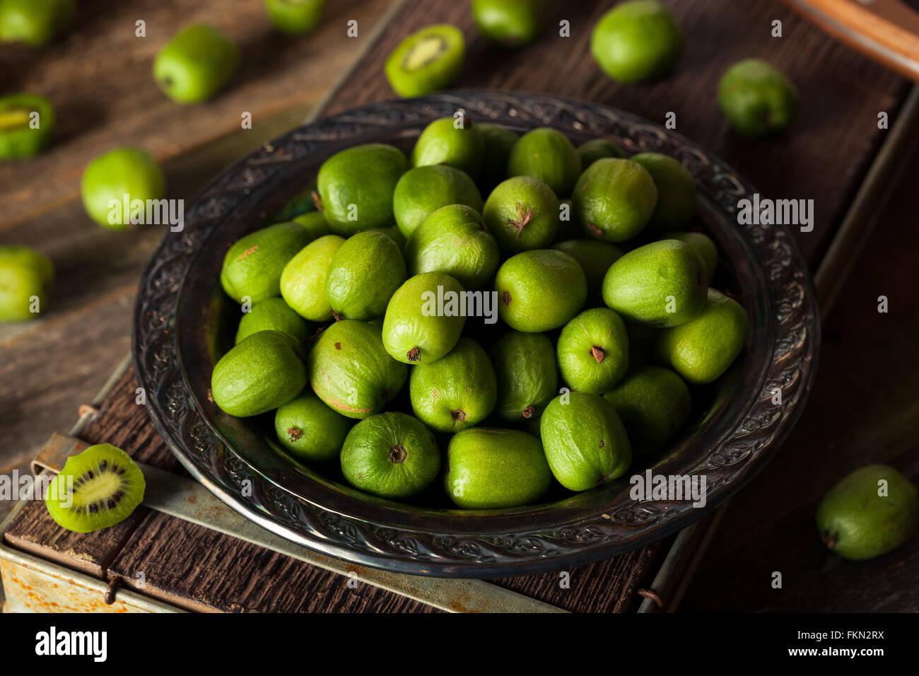 Green Organic Kiwi Berries in a Bowl - Stock Image