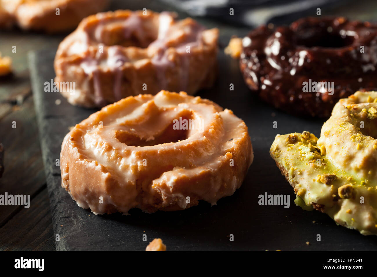 Homemade Old Fashioned Donuts with Chocolate and Glaze - Stock Image