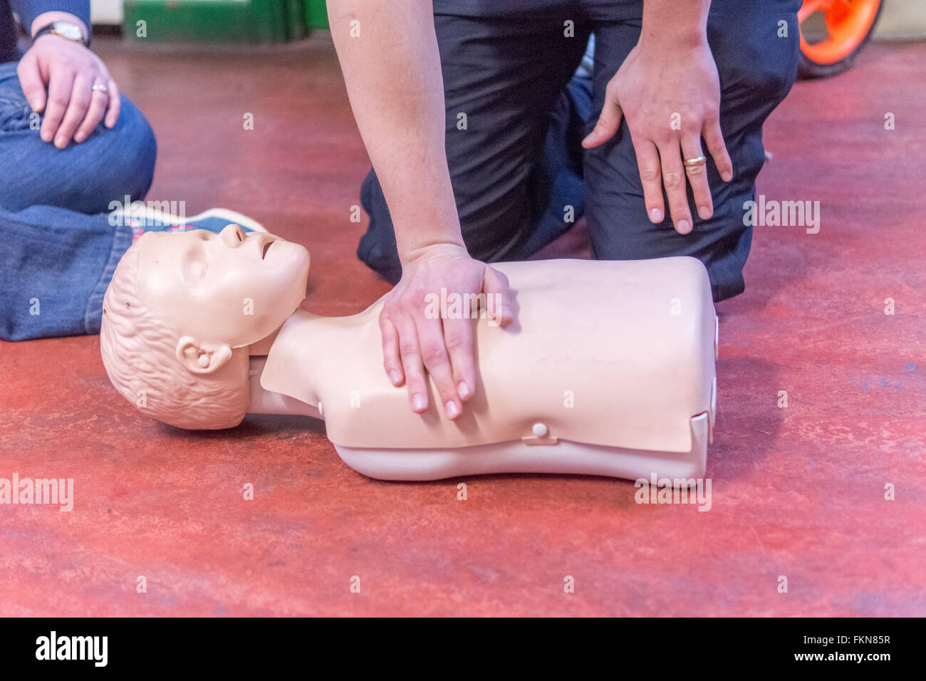 Junior Doctors give basic life support instruction to new mothers, and their families - Stock Image