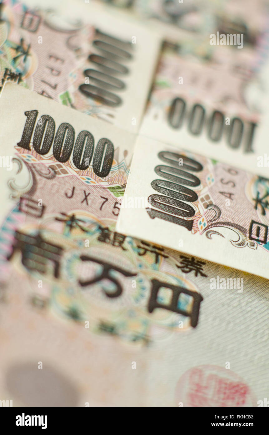 Close up of a pile of interlocked 10000 yen notes Stock Photo