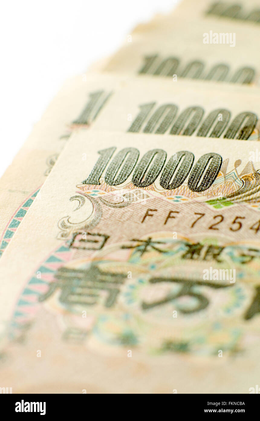 Close up of a pile of 10000 yen notes on white background. Stock Photo