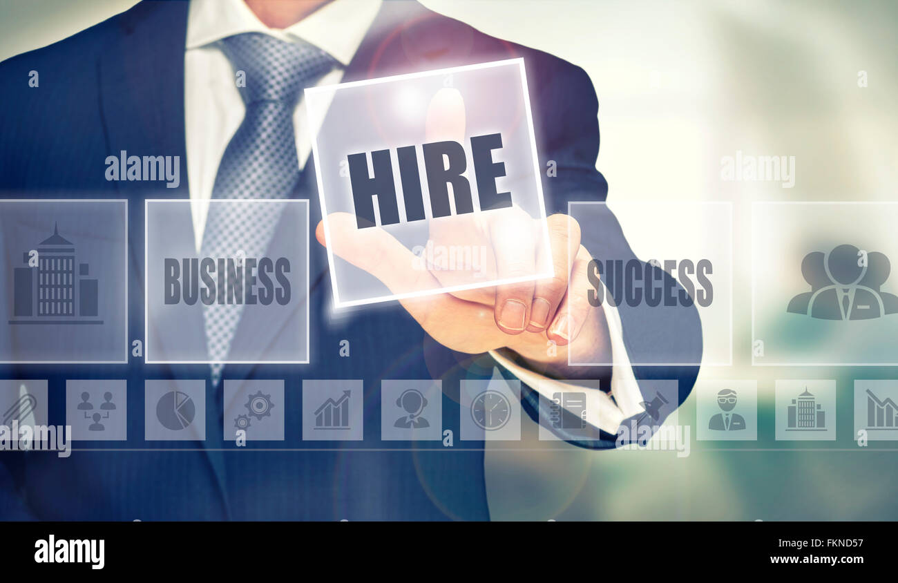 Businessman pressing a Hire concept button. - Stock Image