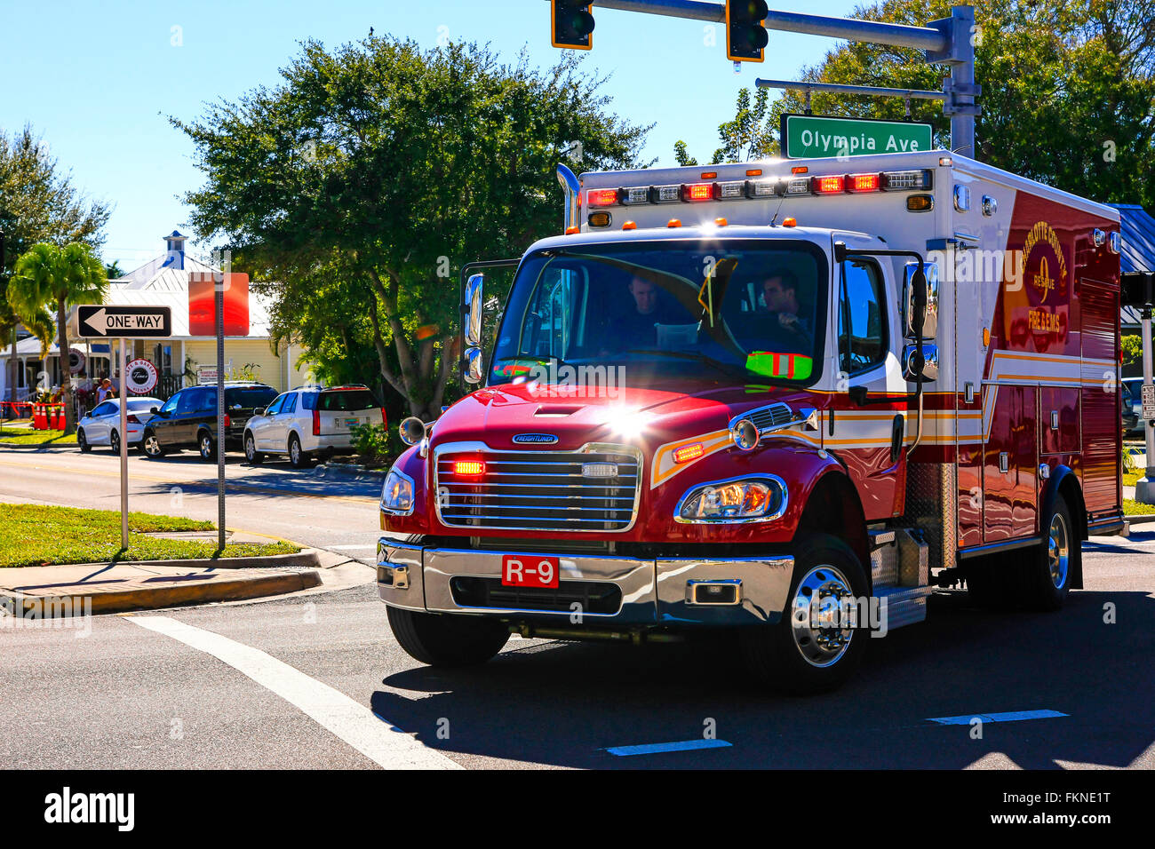 A red Punta Gorda FL EMT wagon on a call out with lights flashing and siren wailing - Stock Image