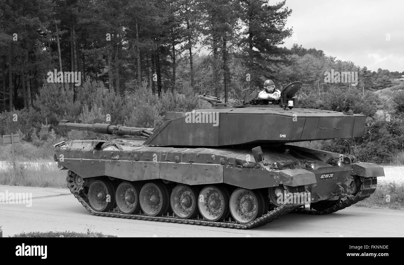 British Challenger tank driving with it turret reversed during a training run. 16th Jul 2016 - Stock Image