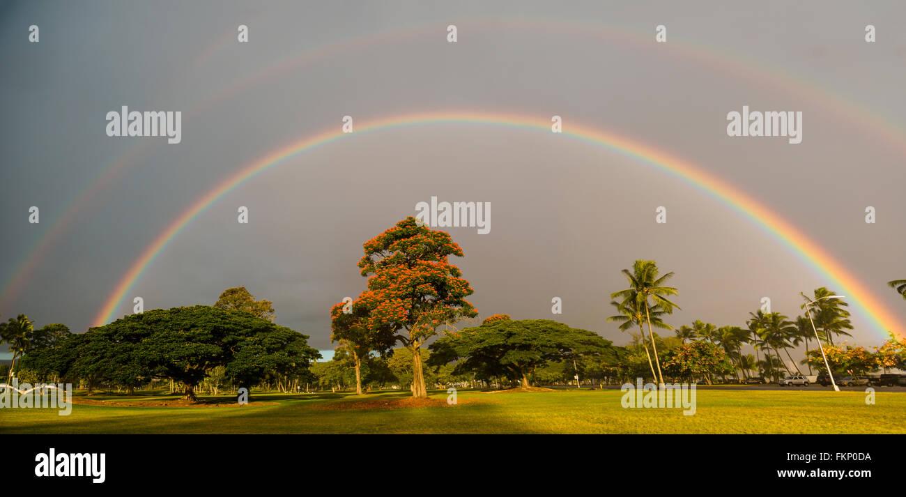 Double Rainbow over the Liliuokalani Park and Gardens  gardens in Hilo, Hawaii, USA. - Stock Image