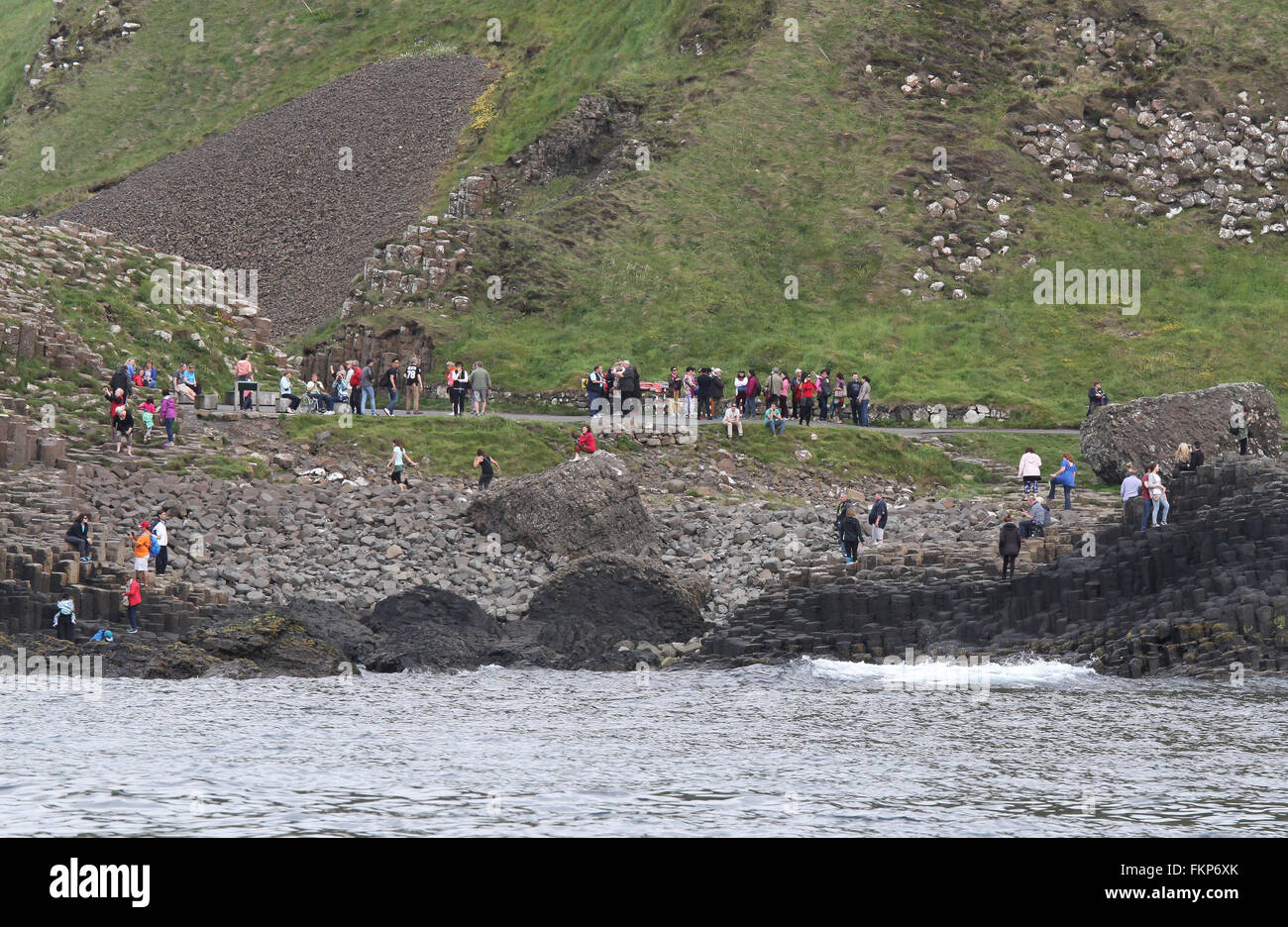 Tourist walking on the Giant's Causeway , County Antrim, Northern Ireland. - Stock Image