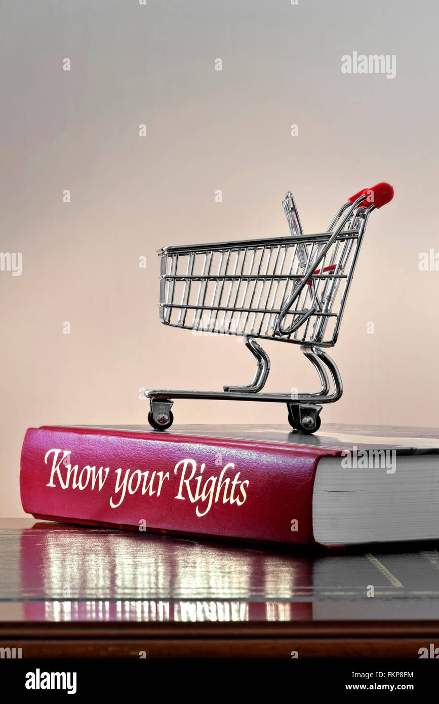 Legal concept of shopping trolley on 'Know your Rights' personal consumer legal advice book on leather bound - Stock Image