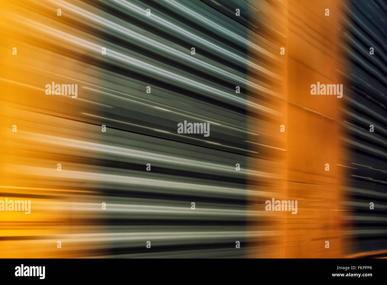 Abstract of train car passing by at rapid speed - Stock Image