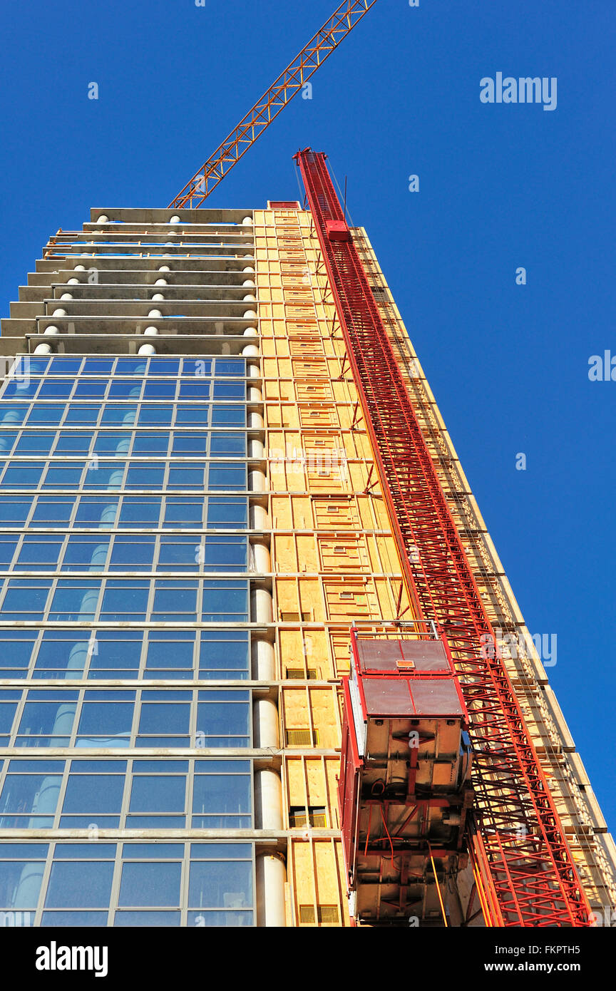 A construction crane keeps pace in growth with the high-rise building it serves on the near north side of Chicago, - Stock Image